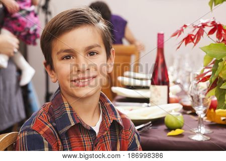 Smiling Hispanic boy at Thanksgiving dinner
