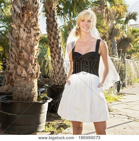 Caucasian bride standing outdoors
