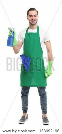 Cleaning concept. Young man in green apron holding cleanser on white background