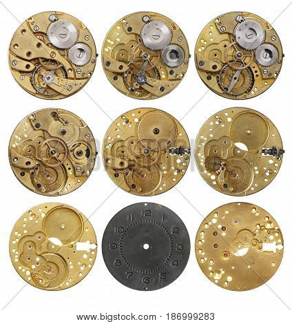 Clockwork mechanism - the various phases dismantling on white background