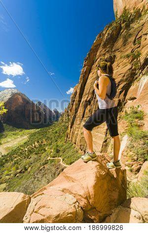 Caucasian woman hiking in canyon