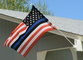 United States flag with blue line to honor police and law enforcement officers poster