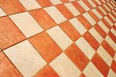 Terracotta and cream tiles in a checked pattern poster