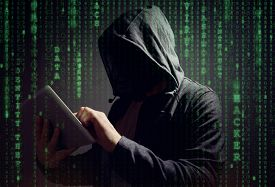 Computer hacker with digital tablet stealing data concept for network security, cyber attack or ransomware