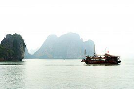 The tourist ship on foggy day Halong Bay Vietnam.