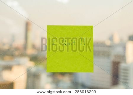 Postit With I Quit Message On Office Window