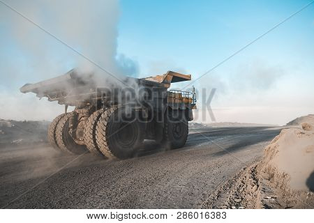 Large Quarry Dump Truck. Loading The Rock In Dumper. Loading Coal Into Body Truck. Production Useful