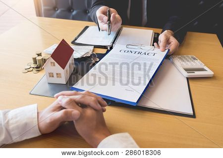 Real Estate Developer Agent And Sign On Document Giving Keys Of New House, Property Agent Giving Off
