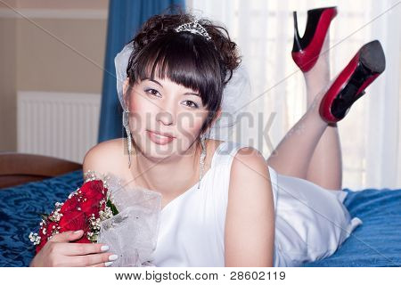 Beautiful Bride On The Wedding Blue Bed