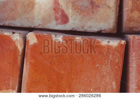 Red Brick Texture Stacked On Top Of Each Other
