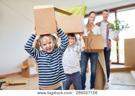 Children enjoy moving and help carry the moving boxes