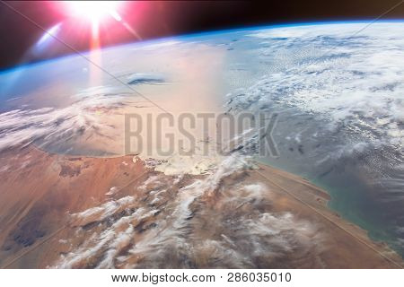 The Sun's Glint Radiates Off The Atlantic Ocean Above The African Mauritania. Elements Of This Image