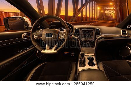 Vision Of A Luxury Autonomous Car Passing Through The Illuminated Tunnel