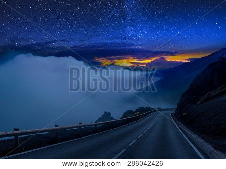 Road Through The Desert Under The Volcano At Night