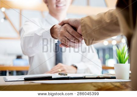 Negotiating Business, Two Confident Business Man Shaking Hands With Partners Together After Finishin