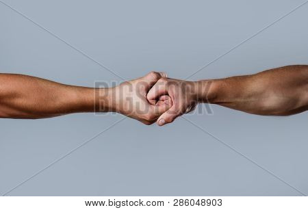 Two Hands, Isolated Arm, Helping Hand Of A Friend. Friendly Handshake, Friends Greeting. Rescue, Hel