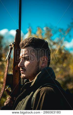 Hunter With Shotgun Gun On Hunt. Hunter In The Fall Hunting Season. Man Holding Shotgun. Deer Hunt.