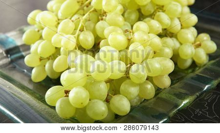 Green Bunch Of Grapes Lying On A Platter. 4k Uhd 3840x2160 Video Clip