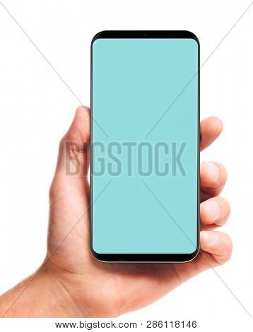 male hand holding bezel-less smartphone with blank screen, isolated on white background . Screen is cut out with path