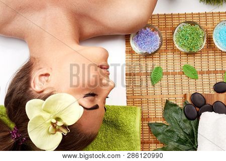 Massage. Spa. Brunette Model Getting Massage Spa  Treatment, Hands Working On Massaging Woman Head A