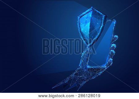 Phone In A Hand With Knight Shield On Blue Smartphone Screen. Abstract Low-poly Wireframe Vector Tec