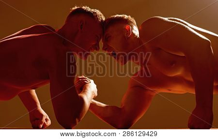 Strength Is What You Seek. Twins Competitors Arm Wrestling. Men Competitors Try To Win Victory Or Re