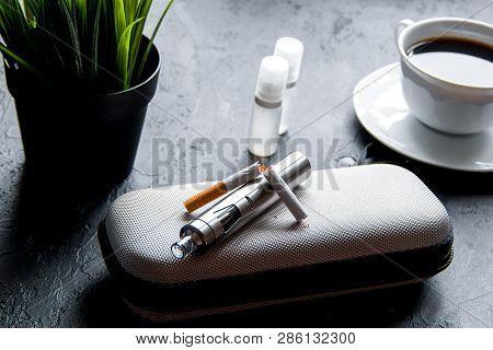 Elimination Of Tobacco Smoking Electronic Cigarette On Dark Background