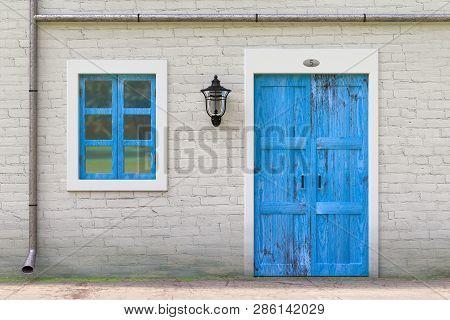 Retro Blue Door, Window, Gutter In Old Grunge White Brick Wall With Vintage Iron Lantern Extreme Clo