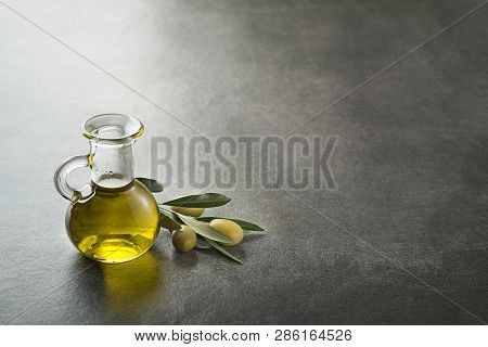 Bottle Of Extra Virgin Healthy Olive Oil With Fresh Olives
