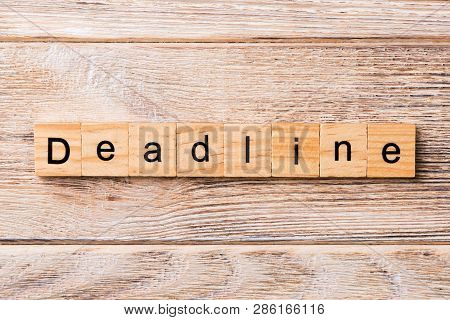 Deadline Word Written On Wood Block. Deadline Text On Wooden Table For Your Desing, Concept