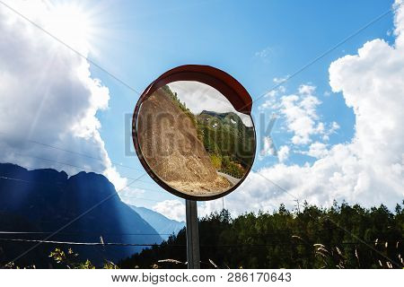 Reflections Of The Road On Traffic Mirror For Traffic Safety. Traffic Mirror
