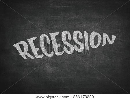 The word recession written on a blackboard poster