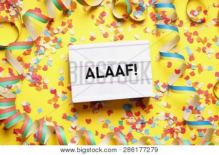 Alaaf Is The Traditional German Fools Call Used During Carnival In Cologne - Flat Lay With Confetti