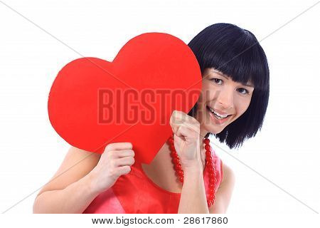 Beautiful smiling woman looks outred heart isolated on white