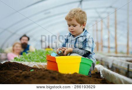Kid In Greenhouse. Happy Kid Work In Greenhouse. Greenhouse Kid Business. Kid In Greenhouse With Sma
