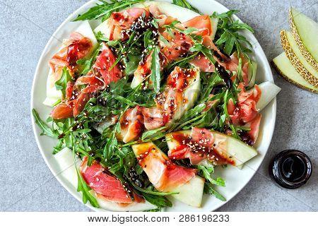 Salad Melon Prosciutto With Arugula. Italian Cuisine. Fresh Melon With Prosciutto. Traditional Itali