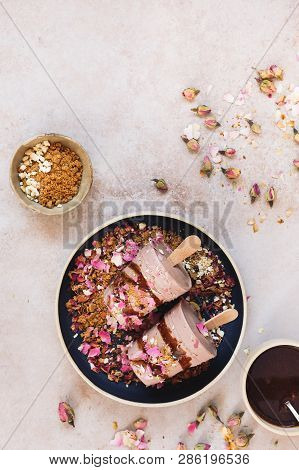 Delicious Masala Chai Kulfi Served With Biscuit Crumbles, Chocolate Syrup And Some Dry Rose Petals O