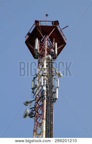 Communication tower 3G or 4G network telephone cellsite silhouette on blue sky. Implementation of communication standard 5G poster