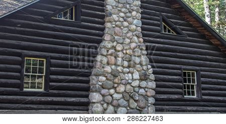 Log Cabin Lodge. Exterior Wall And Chimney Of Historic Log Cabin Lodge Built By The Ccc And Located