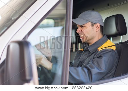 Angry driver shouting at the traffic