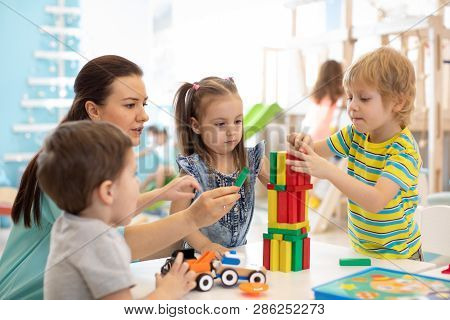 Little Kids Build Wooden Toys At Home Or Daycare. Kids Playing With Color Blocks. Educational Toys F