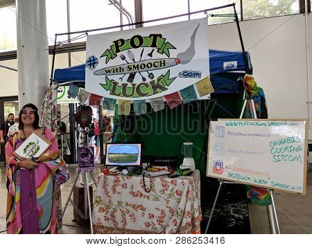Honolulu - February 10, 2018: Woman Smiles At Potluck With Smooch Booth At The 3rd Annual Hawaii Can