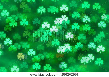 St Patricks Day green shamrock bokeh background. Illuminated bokeh with shamrock as a symbol of St Patrick's day, abstract St Patricks Day background, St Patricks Day card
