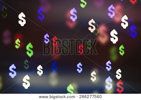 Bokeh In The Form Of A Dollar Sign. The Concept Of Wealth And Money, Trading On The Stock Exchange A