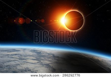 Solar Eclipse And Earth. Solar Eclipse, Mysterious Natural Phenomenon When Moon Passes Between Plane