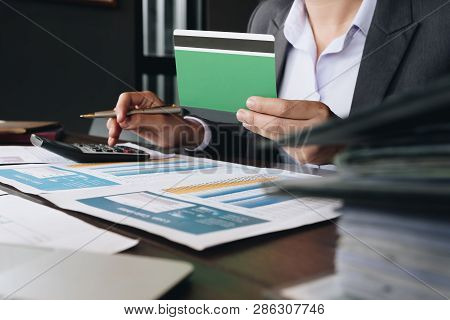 Accountant Calculating The Saving Account Book And Statement Of Financial Statements At Home. Accoun