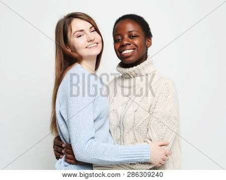 Shot of happy interracial homosexual couple hugging