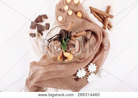 Chocolate Ice Cream Cookie Dessert Top Flat Lay. Cold Delicious Brown Icecream Ball And Mint Biscuit