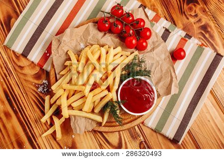 French Fries Potato Snack Ketchup Sauce Flat Lay. Golden Fry Chip Fast Food On Wooden Rustic Table.