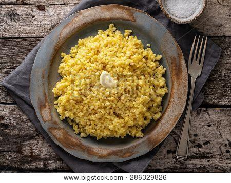 Bulgur Wheat. Boiled Bulghur Cereal In Plate On Dark Old Wooden Table. Healthy Vegetarian Food, Top